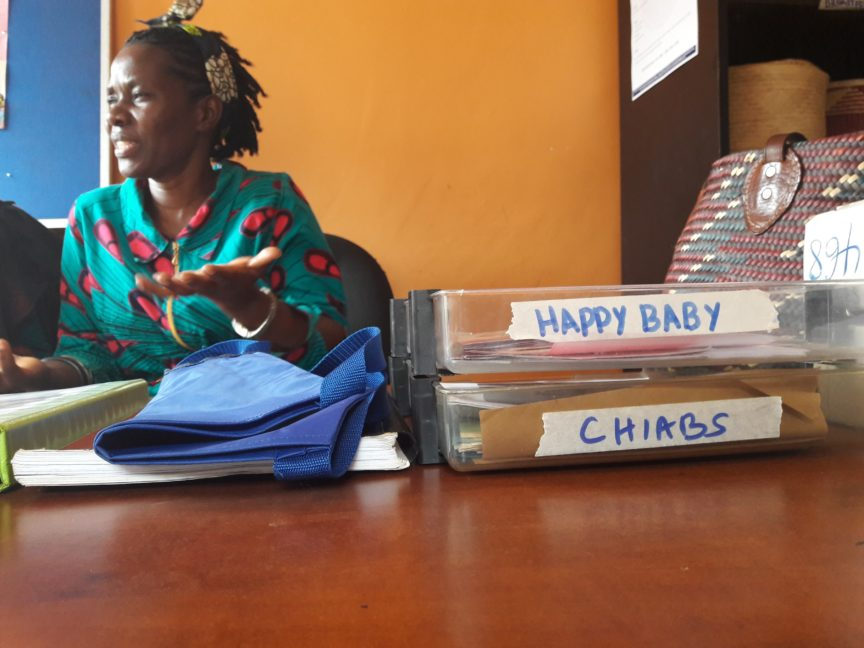 HB Project Leader Josephine sits behind a desk in the CHIABS office